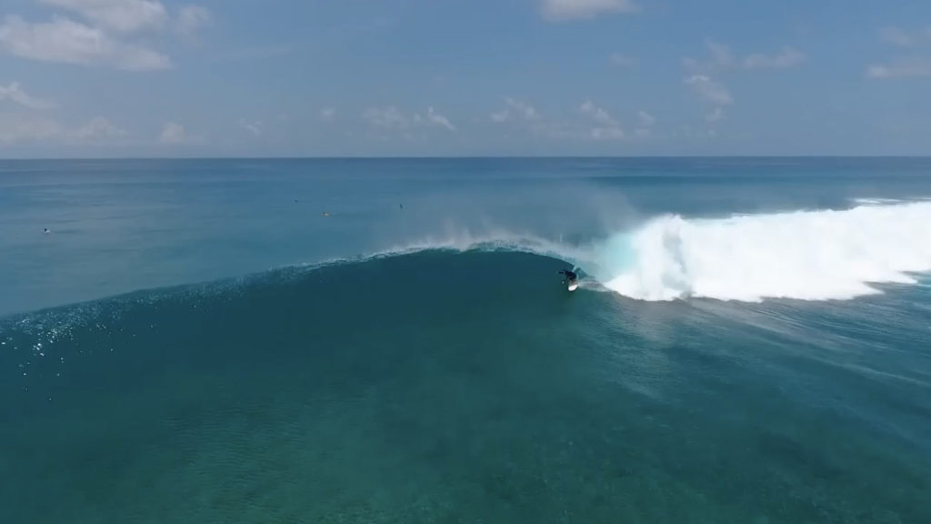 Pascal surfing cokes in the Maldives